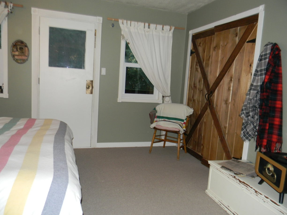 master bedroom w/ covered deck