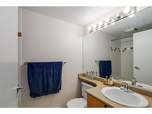 Second bathroom with a tub/shower combo.