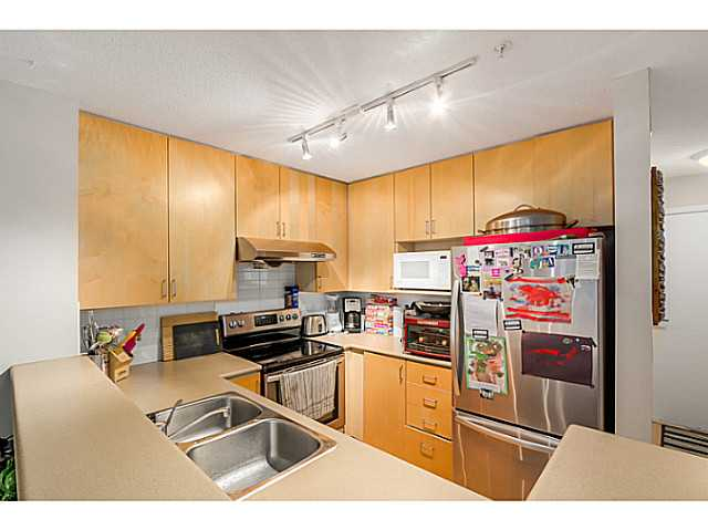Generous size kitchen with good cupboard space.