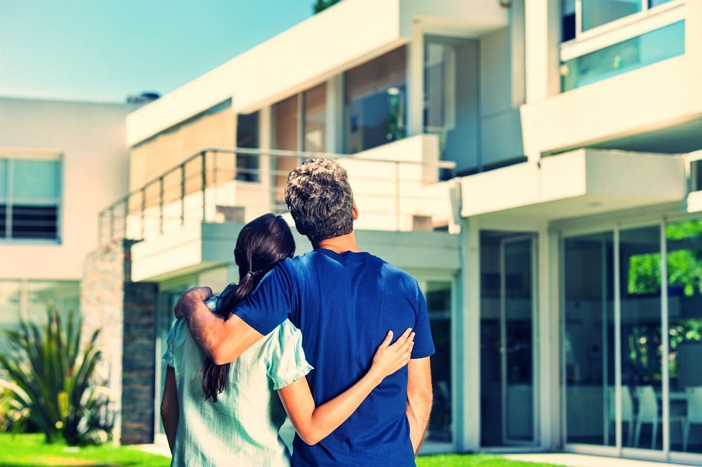 Home buyers looking and viewing home for sale