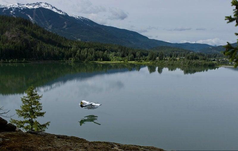 Float plane landing on Green Lake in Whistler Ski Resort