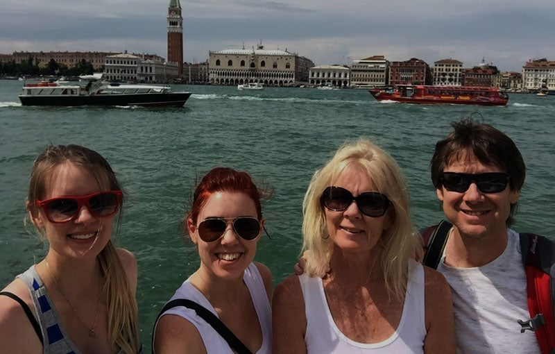Family picture of Italy holiday in Venice with lagoon in background