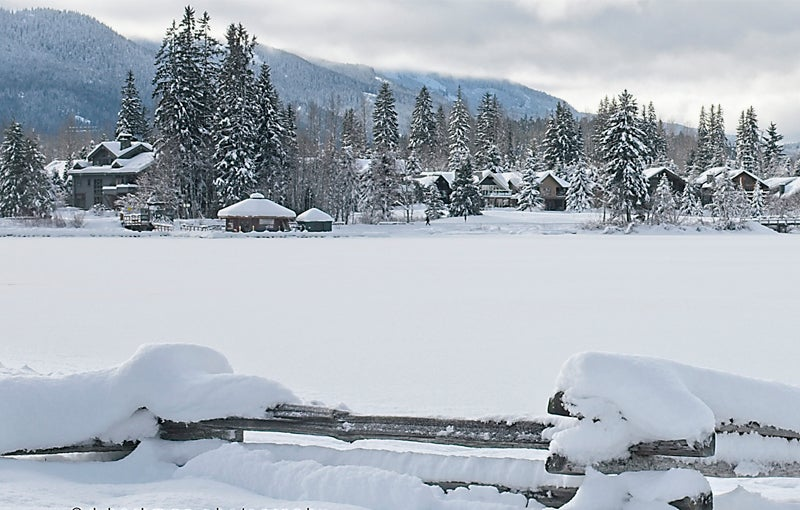 looking across snow covered Green Lake to houses