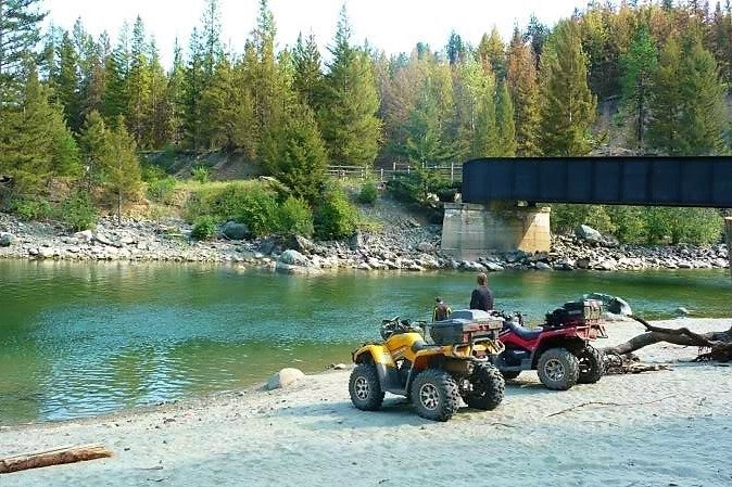 Riverside ATVing overlooking the Trans Canada Trail (KVR)