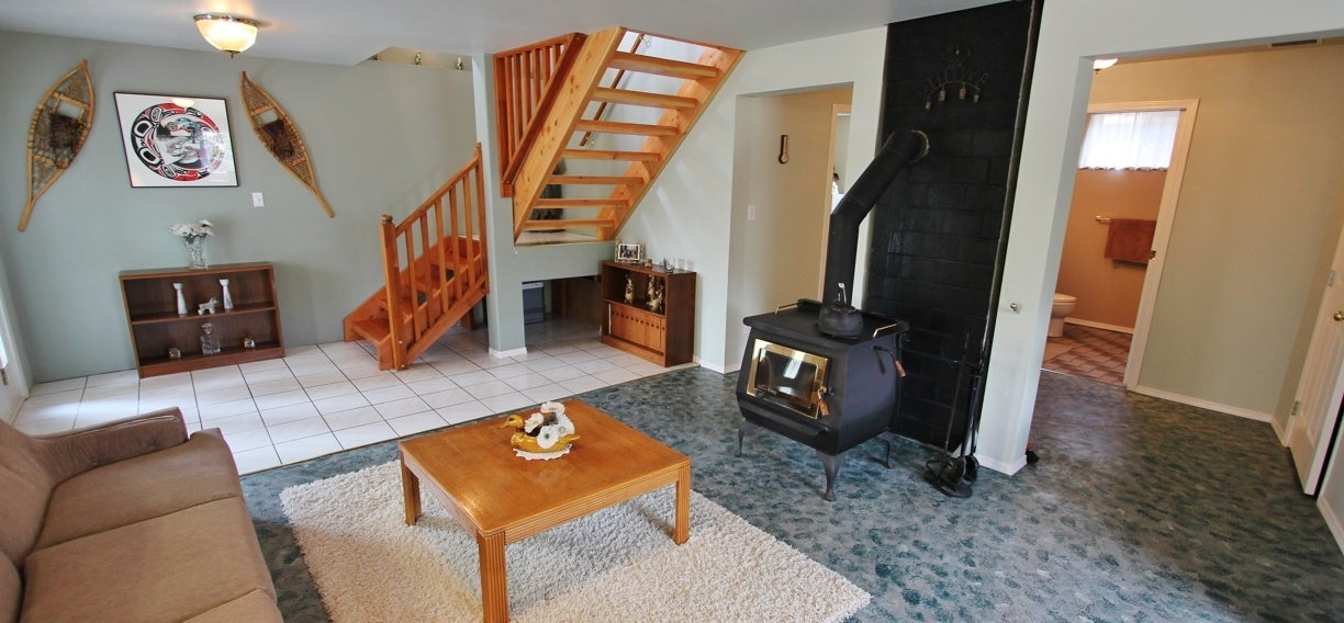 Living space and wood stove at 2238 Princeton Summerland Road