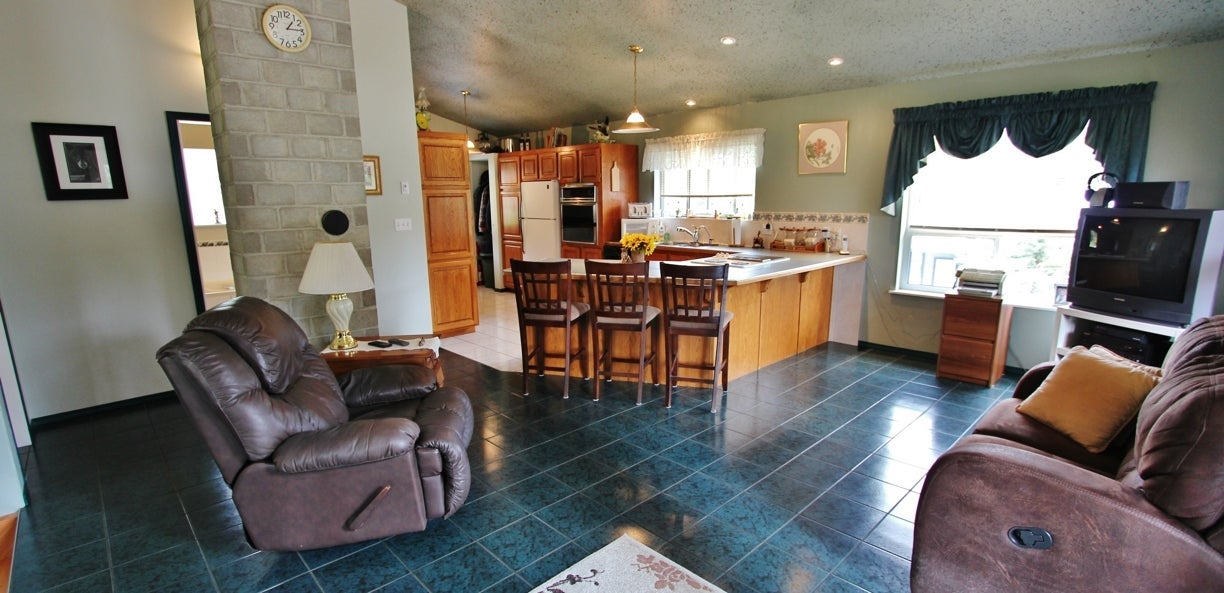 The kitchen and living room at 2238 Princeton Summerland Road