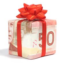 fifty dollar bill shaped in a block with red ribbon