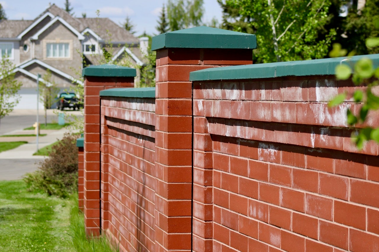red brick fence in Pineview St. Albert
