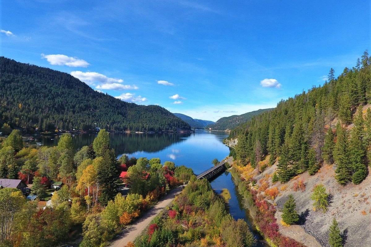 Arial view overlooking Otter Lake and Otter Creek with blue skies in Tulameen BC