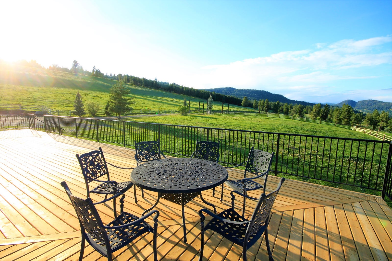 Cast iron patio furniture on a wooden deck deck looking North of Princeton. . Links to Selling page.